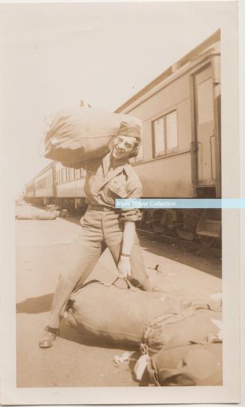 Leonard Sonny Cummings WWII carrying his gear watermark
