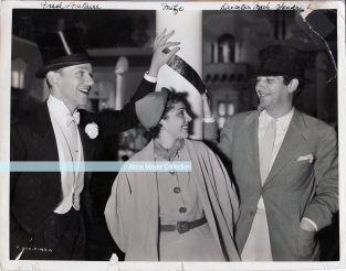 Fred Astaire with Mitzi Cummings and director Mark Sandrich, in a photo taken for Mitzi's Photoplay magazine column.